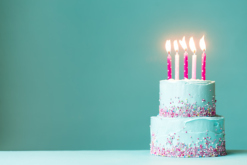 istock Birthday cake with pink candles 918219026