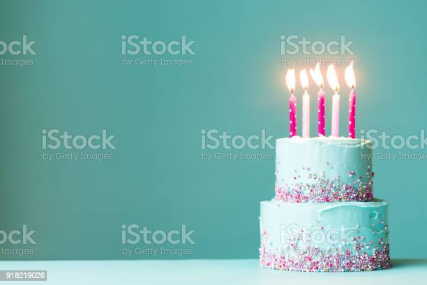 Birthday cake with pink candles picture id918219026?b=1&k=6&m=918219026&s=612x612&h=06te2mylraa8ufxiymnyojxauwqzkn5 jvn5p7tma8y=