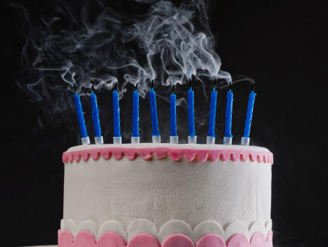 Birthday Cake With Smoking Blown Candles Stock Photo More Pictures Of Anniversary
