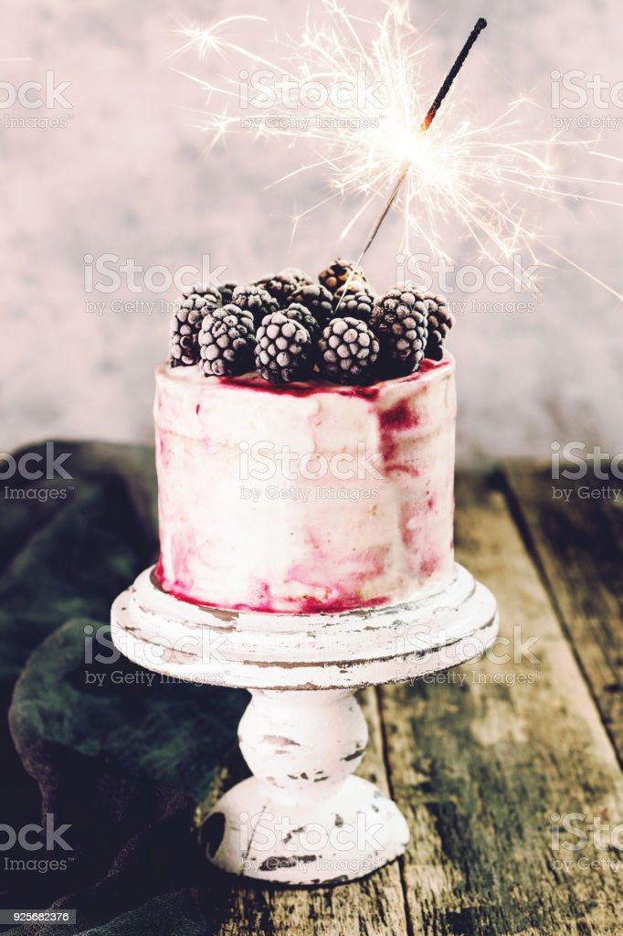 Birthday Cake With Sparkler On Wooden Vintage Table Stock Photo