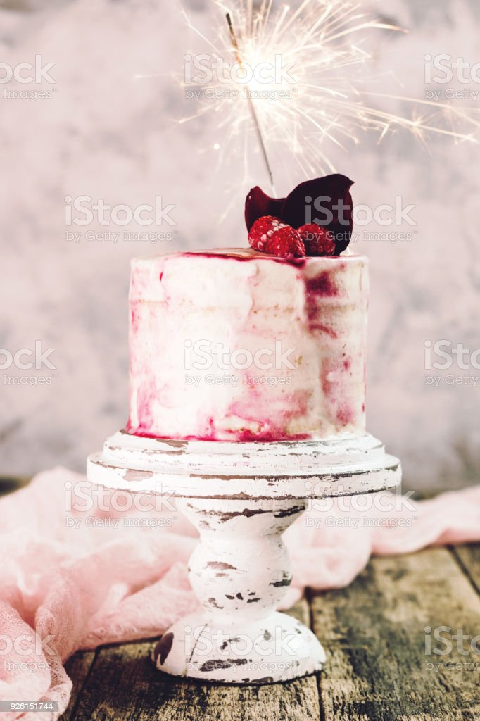 Birthday Cake With Sparkler On Wooden Vintage Table Royalty Free Stock Photo