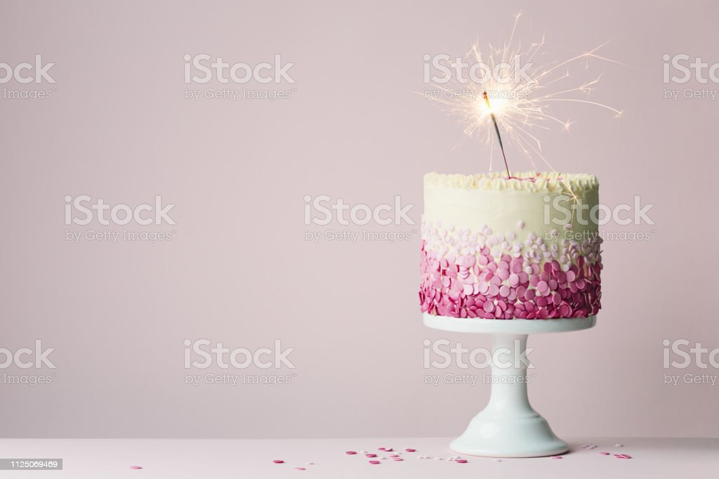 Pleasing Birthday Cake With Sparkler Stock Photo Download Image Now Istock Funny Birthday Cards Online Fluifree Goldxyz