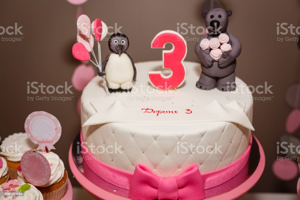 Birthday cake with the number three for a girl stock photo