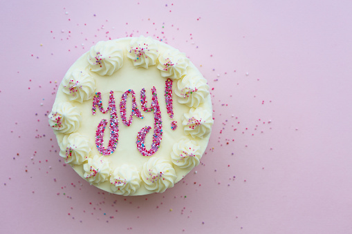 Birthday cake with yay written in colorful sprinkles