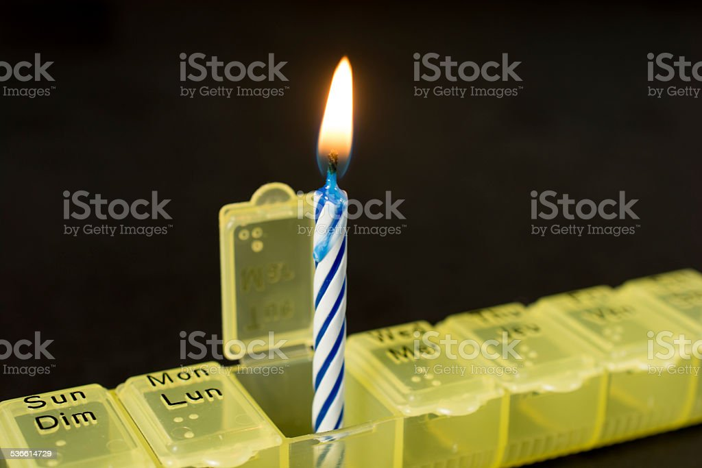 Birthday Candle On Black In Pill Box