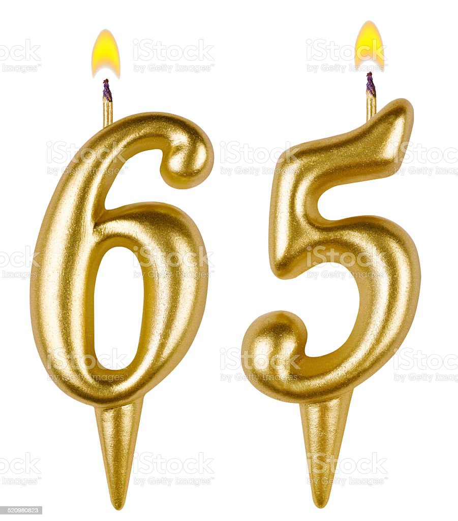 Birthday candles number sixty five isolated on white background stock photo
