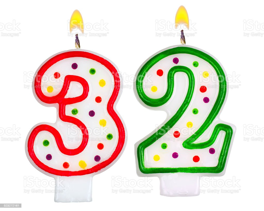 Birthday candles number thirty two isolated on white background stock photo