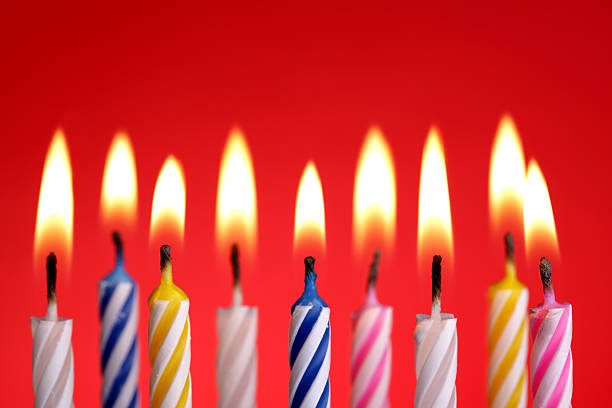 Birthday candles on red stock photo
