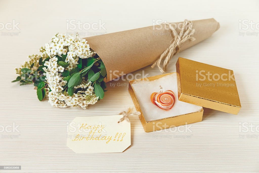 Birthday Card.Golden Present Box. Bouquet Flowers.White Wooden Texture royalty-free stock photo