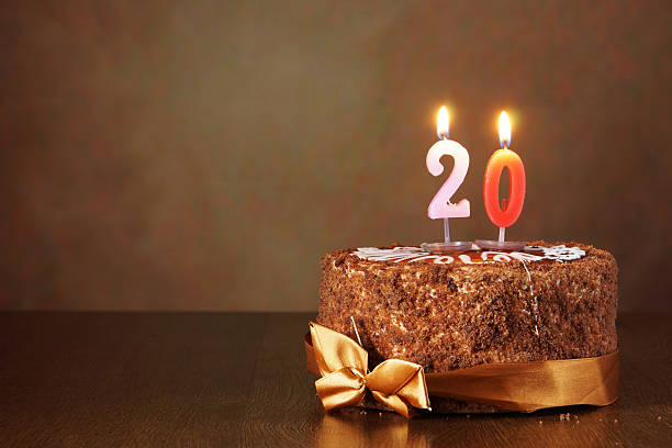 birthday chocolate cake with burning candles as a number twenty - number 20 stock photos and pictures