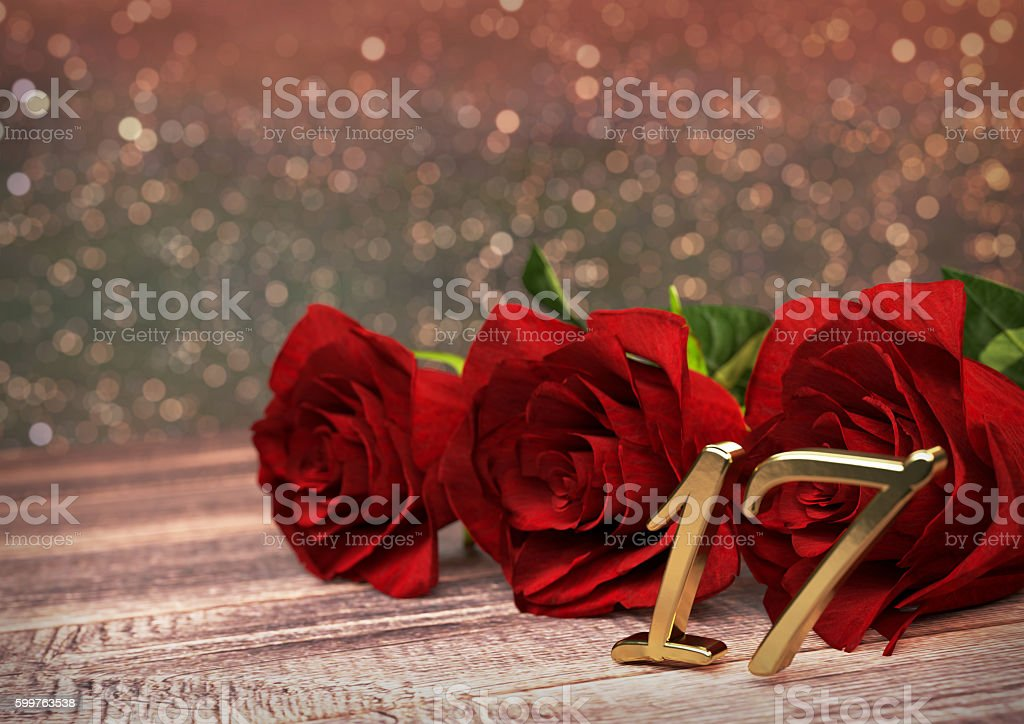 birthday concept with red roses on wooden desk. seventeenth. 17th stock photo
