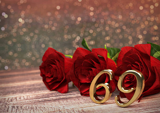 birthday concept with red roses on wooden desk. sixty-nineth - number 69 stock photos and pictures