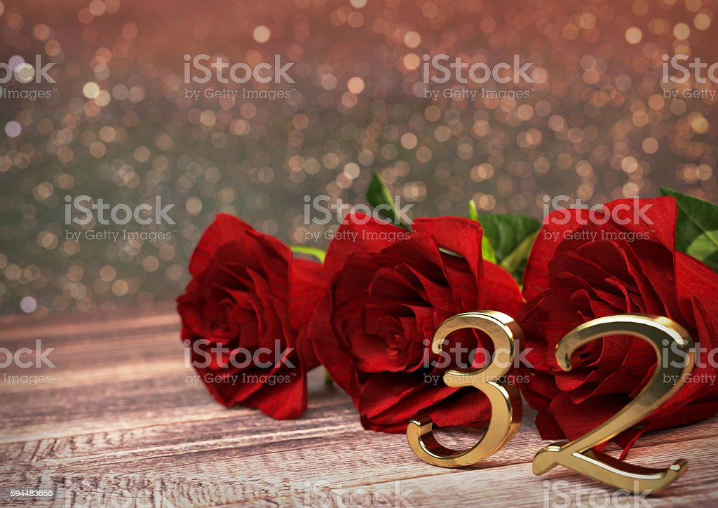 birthday concept with red roses on wooden desk. thirty-second stock photo