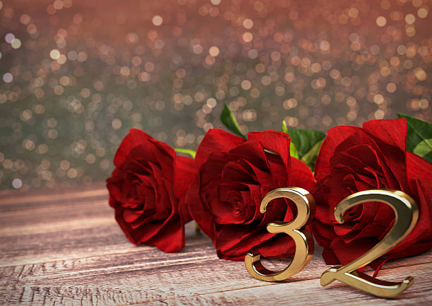 birthday concept with red roses on wooden desk. thirty-second birthday concept with red roses on wooden desk. 3D render - thirty-second birthday. 32nd 32nd birthday stock pictures, royalty-free photos & images