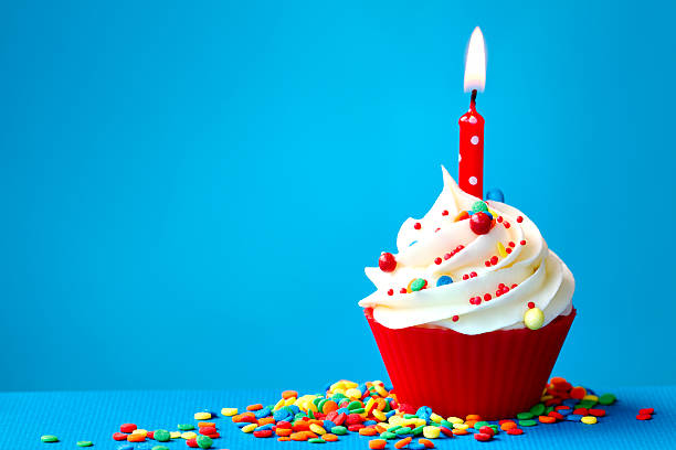 Birthday cupcake Cupcake decorated with a single candle first birthday stock pictures, royalty-free photos & images