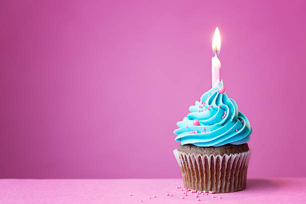 Birthday cupcake Birthday cupcake with a single candle first birthday stock pictures, royalty-free photos & images