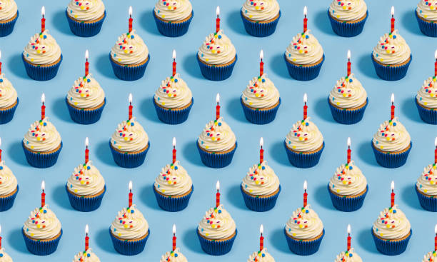 Birthday cupcake seamless pattern Seamless pattern with birthday cupcakes and candles on a blue background birthday candle stock pictures, royalty-free photos & images
