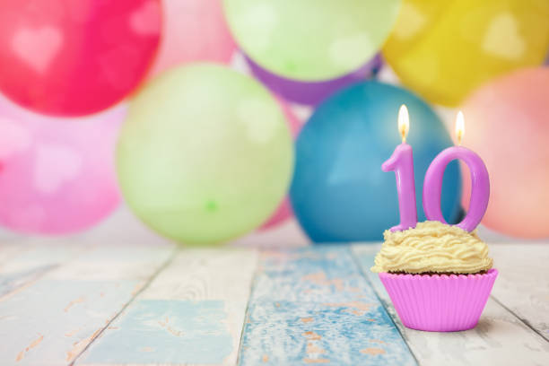 birthday cupcake with balloons in the background - number 10 stock photos and pictures