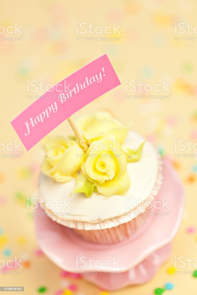 Birthday Cupcake With Happy Sign On Cake Stand Confetti