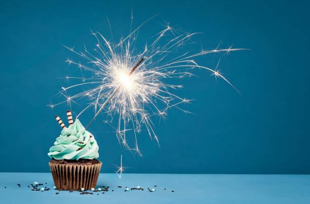 Birthday Cupcake with sparkler stock photo