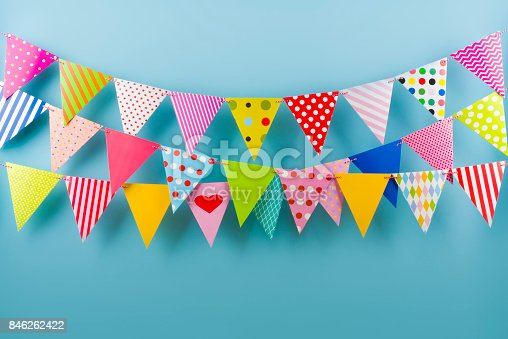 istock Birthday fest garlands from colorful triangular flags on blue background 846262422