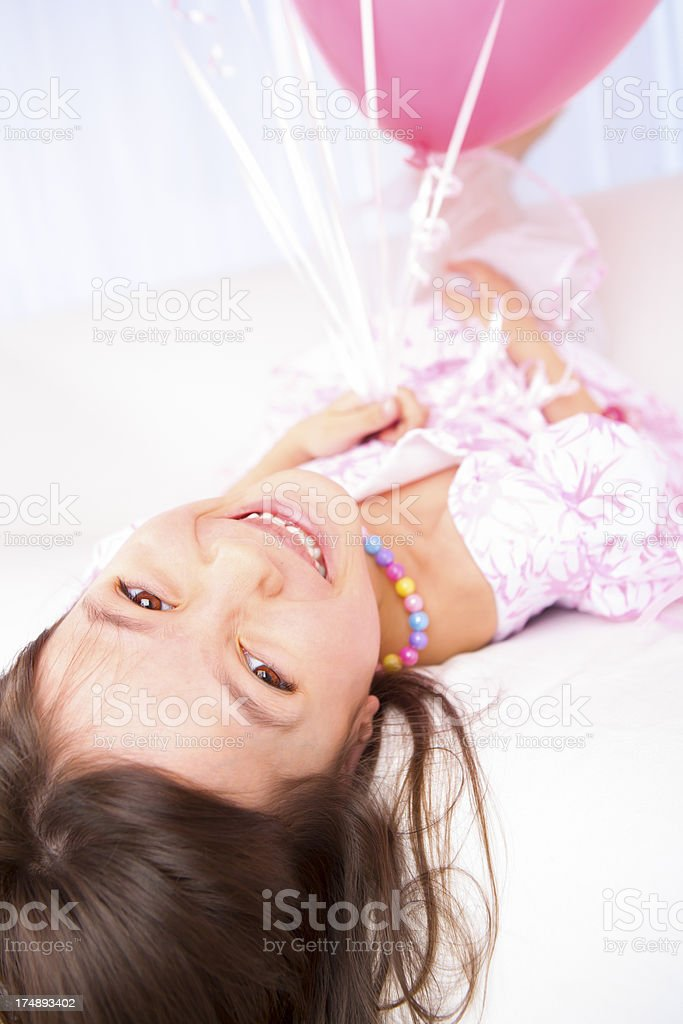 Birthday girl being playful royalty-free stock photo