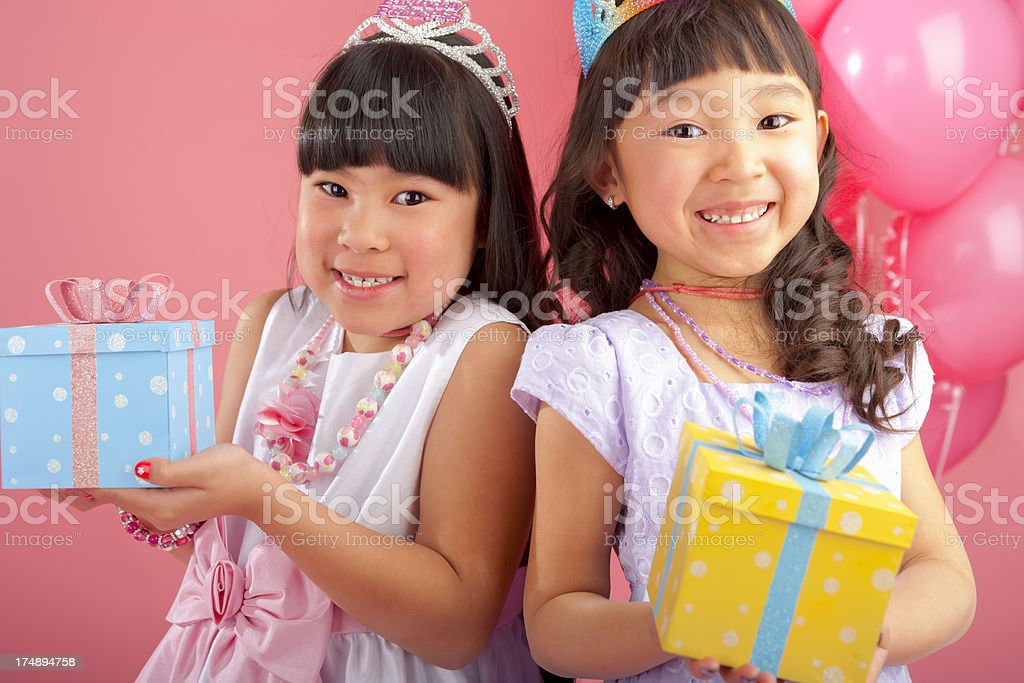 Birthday girl celebrating with her sister royalty-free stock photo