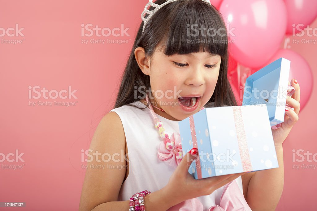 Birthday girl surprised at her gift royalty-free stock photo