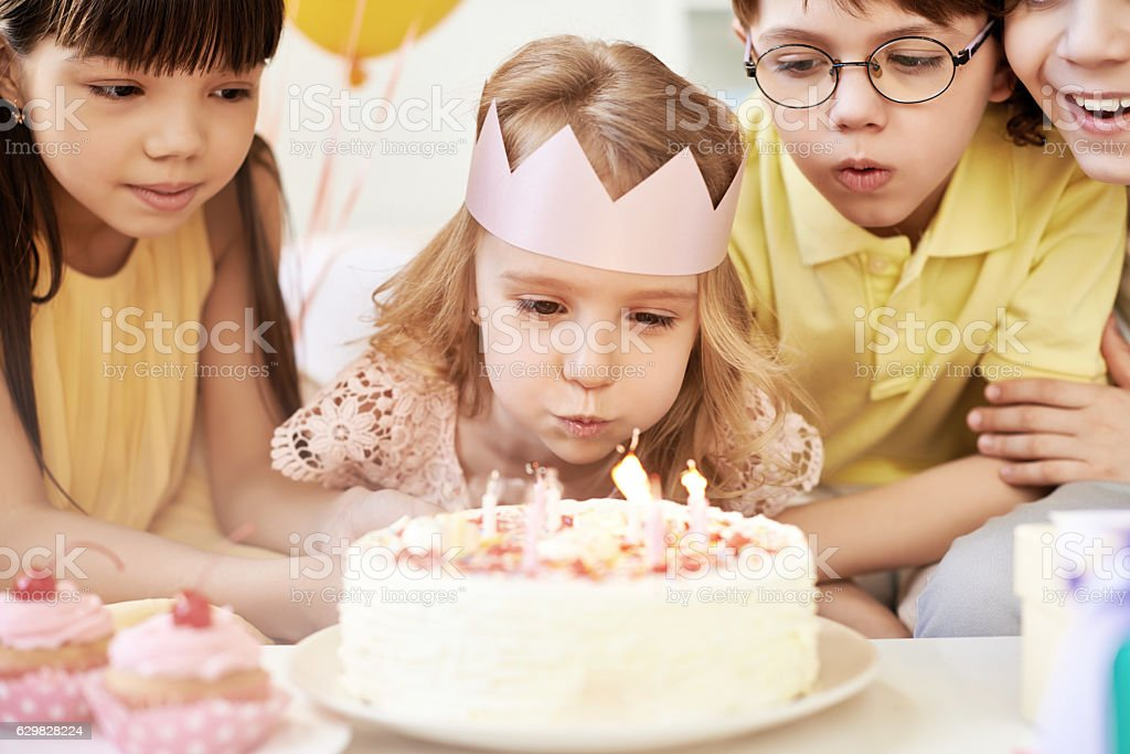 Birthday girl with friends stock photo