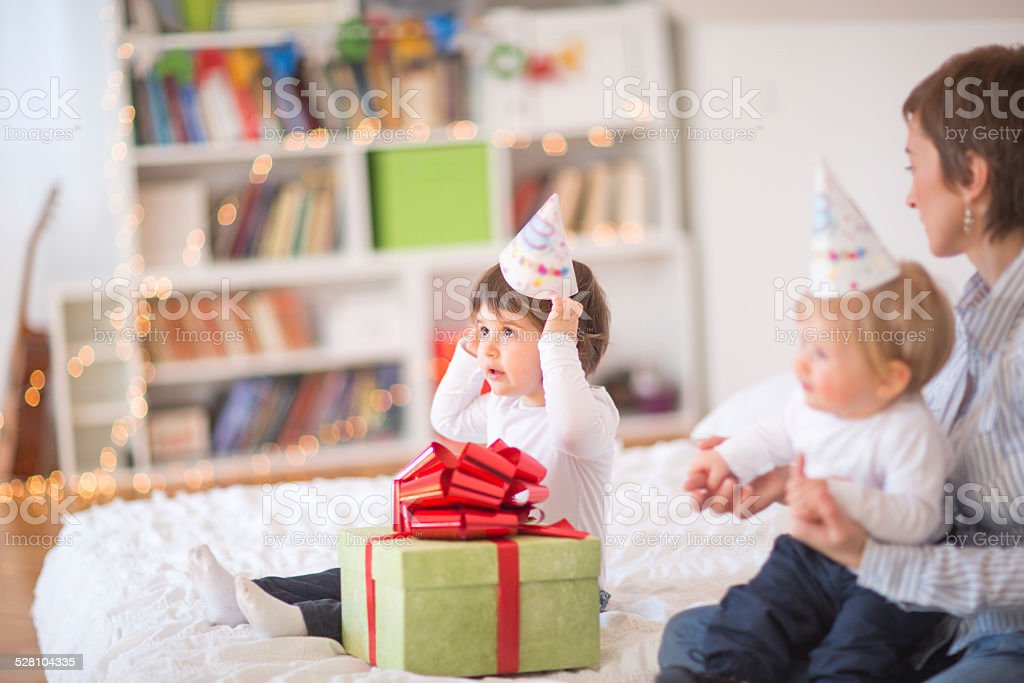 Birthday girl with her family stock photo