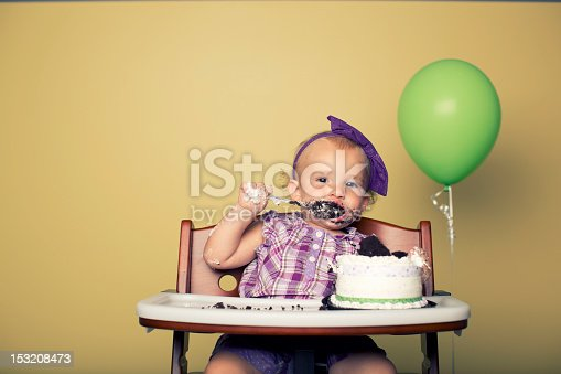 A one year old celebrates her first birthday with too much cake.