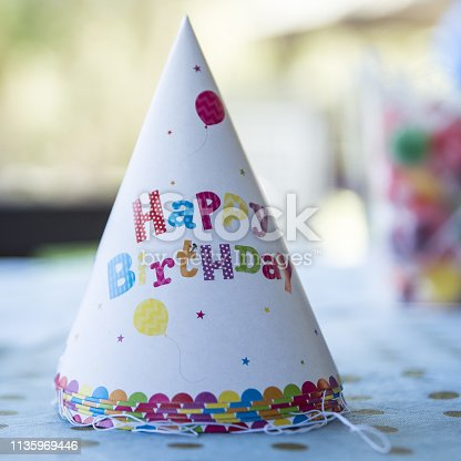 istock Birthday hat on a table 1135969446