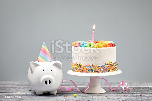 istock Birthday Money Concept with Rainbow Iced Cake 1143262606
