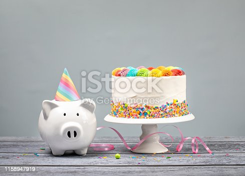istock Birthday Money Concept with Rainbow Iced Cake 1158947919