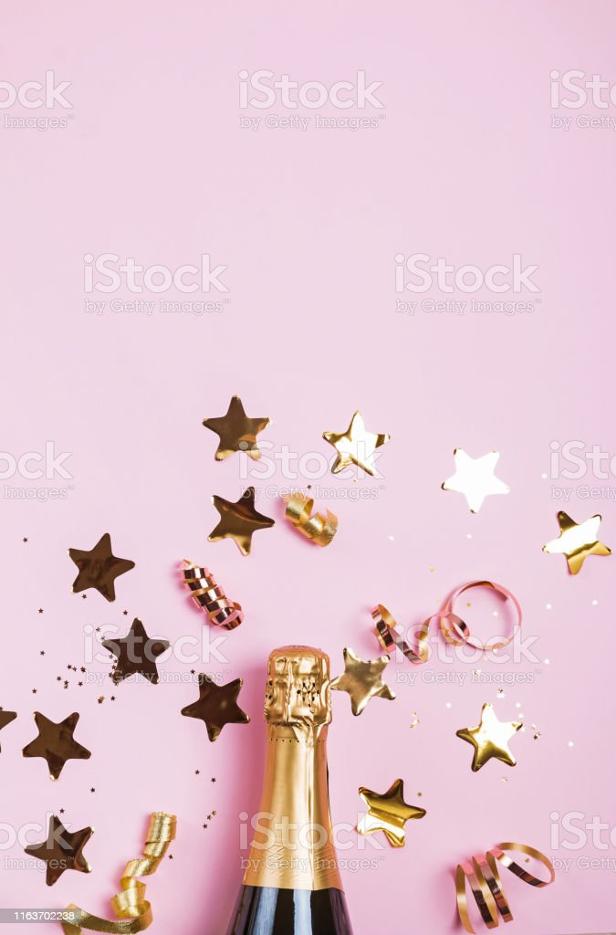 Birthday or Christmas party decor on pink baqckground. Golden...