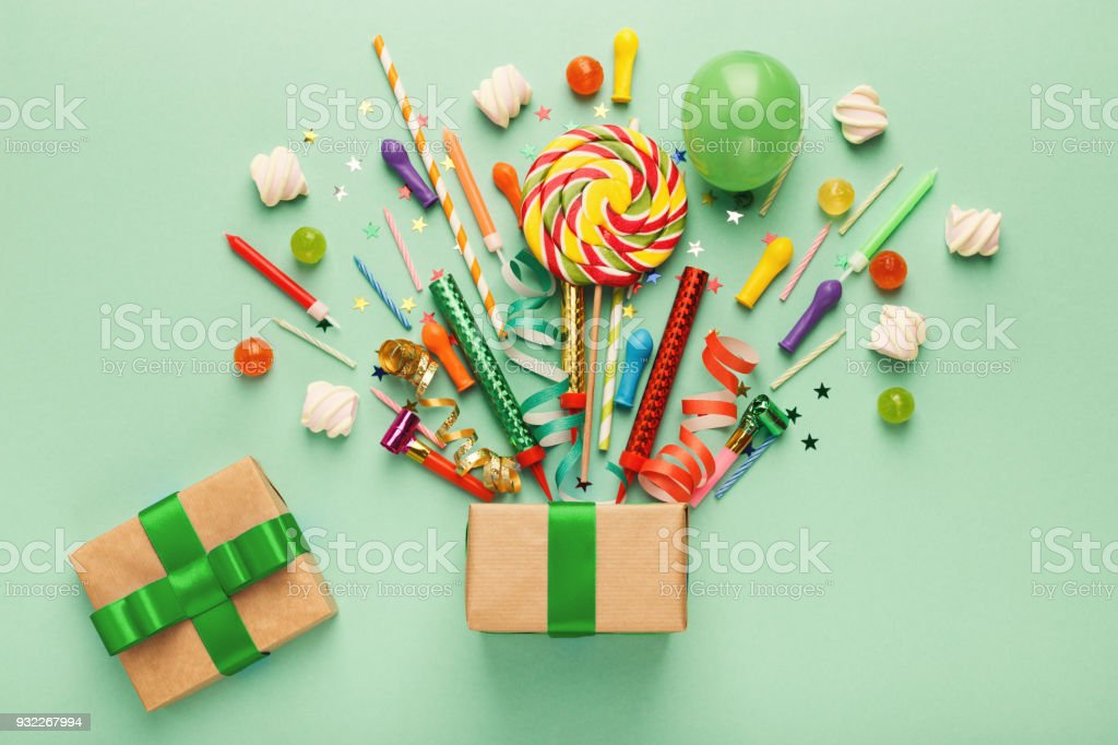 Birthday party background with gift and lollipops stock photo