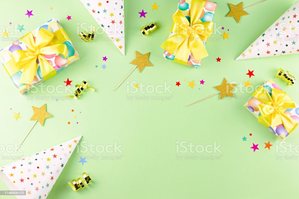 Birthday party background with wrapped gifts, confetti, party hats,...