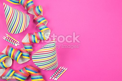 950793576 istock photo Birthday party composition on pink background. Top view with copy space. 942809180