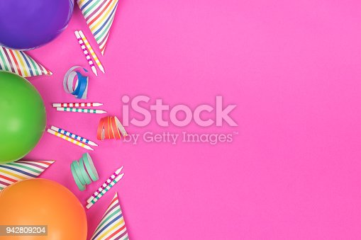 950793576 istock photo Birthday party composition on pink background. Top view with copy space. 942809204