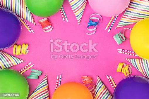 950793576 istock photo Birthday party composition on pink background. Top view with copy space. 942809206