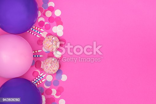 950793576 istock photo Birthday party composition on pink background. Top view with copy space. 942809260