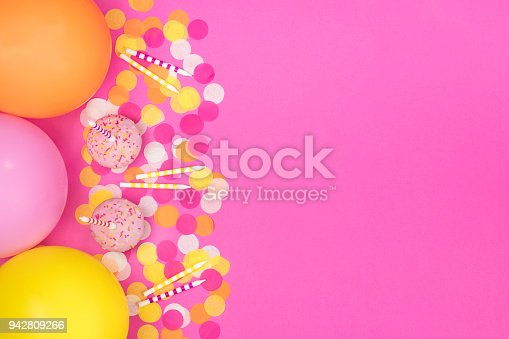 950793576 istock photo Birthday party composition on pink background. Top view with copy space. 942809266