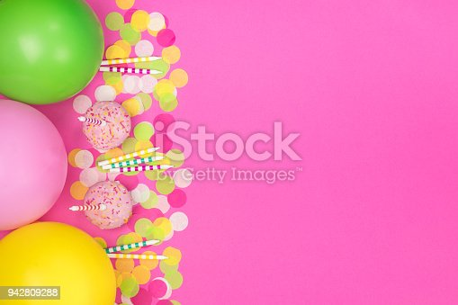 950793576 istock photo Birthday party composition on pink background. Top view with copy space. 942809288