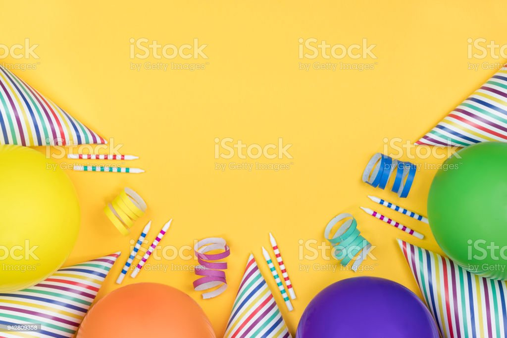 Birthday party composition on yellow background. Top view with copy space. stock photo
