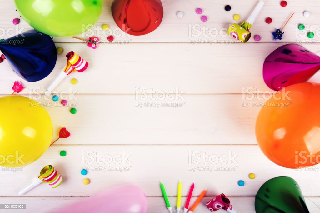 birthday party items on white wooden background. top view stock photo