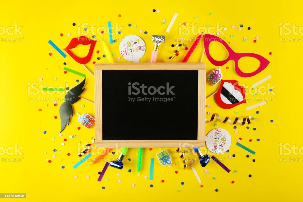 Photo booth props, blank blackboard, paper moustache, lips & glasses...