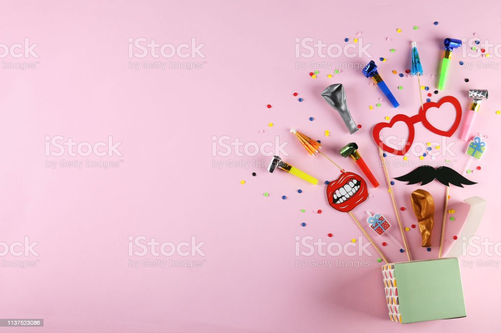 Different photo booth props on bright pink background. Paper...