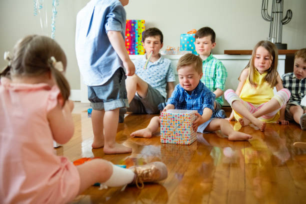 birthday party of little boy with down syndrome - all vocabulary foto e immagini stock