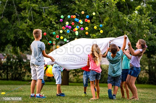 children are playing, throwing balls at a birthday party