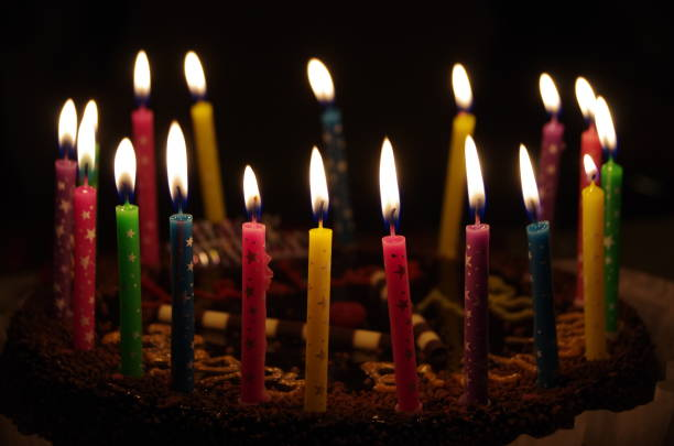 Birthday party Birthday cake lit with candles. birthday candle stock pictures, royalty-free photos & images